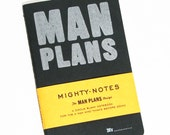 Man Plans Single Moleskine Notebook