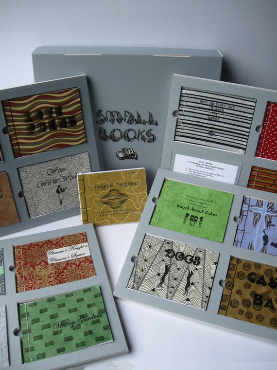 "Small Books: 16 Hand-made, ""Artisan"" Books Inset in Framed Pages, Thumb Holes for Easy Retrieval, Housed in a Reinforced Clamshell Box"