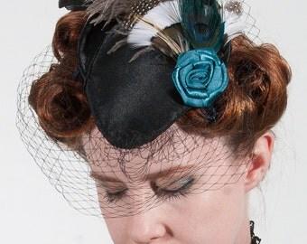 Sally black satin teardrop hat with blue rose