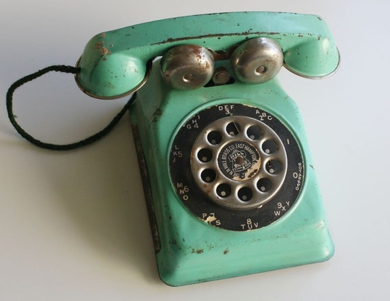 Vintage N.N. Hill Brass Co. Tin Toy Rotary Telephone