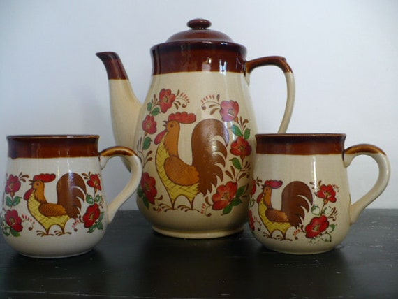 Vintage floral and chicken tea or coffee pot with two matching mugs