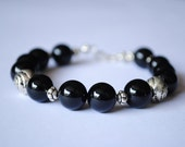 A Handmade Bracelet in Black Onyx Stone with Silver Plated Beads