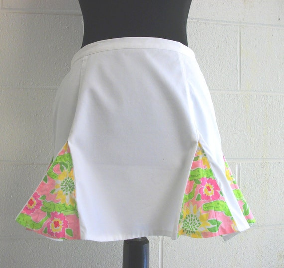 Lilly Pulitzer White mini with pink and green crocodile and flower kick pleats size 4