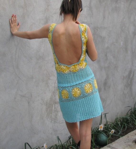 A soft blue and yellow hand crochet dress