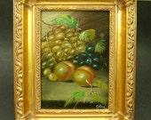 Vintage oil painting in ornate gilt frame.