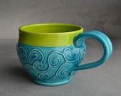 Curly Mug: Caribbean Blue and Neon Green Slip Trailed Mug by Symmetrical Pottery