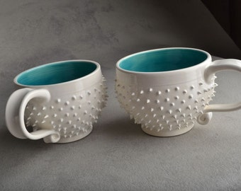 Spiky Mugs: Made To Order Pair of White and Blue Dangerously Spiky Cocoa/Soup Mugs by Symmetrical Pottery