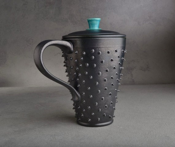 Tall Lidded Spiky Mug: Black and Caribbean Blue Dangerously Spiky Lidded Travel Mug by Symmetrical Pottery