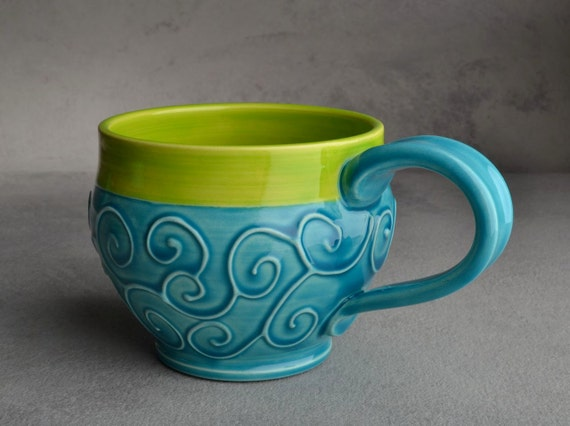 Curly Mug: Caribbean Blue and Neon Green Slip Trailed Mug by Symmetrical Pottery