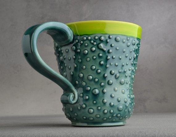 Curvy Dottie Mug: Peacock Green Neon Green Curvy Dottie Mug by Symmetrical Pottery