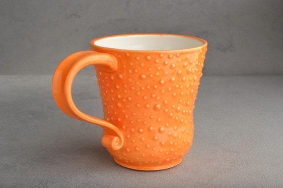 Curvy Dottie Mug: Orange and White Curvy Dottie Mug by Symmetrical Pottery