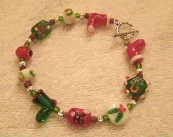 Red and Green Santa Boot Holiday Lamp-work Glass and Crystal Beaded Bracelet