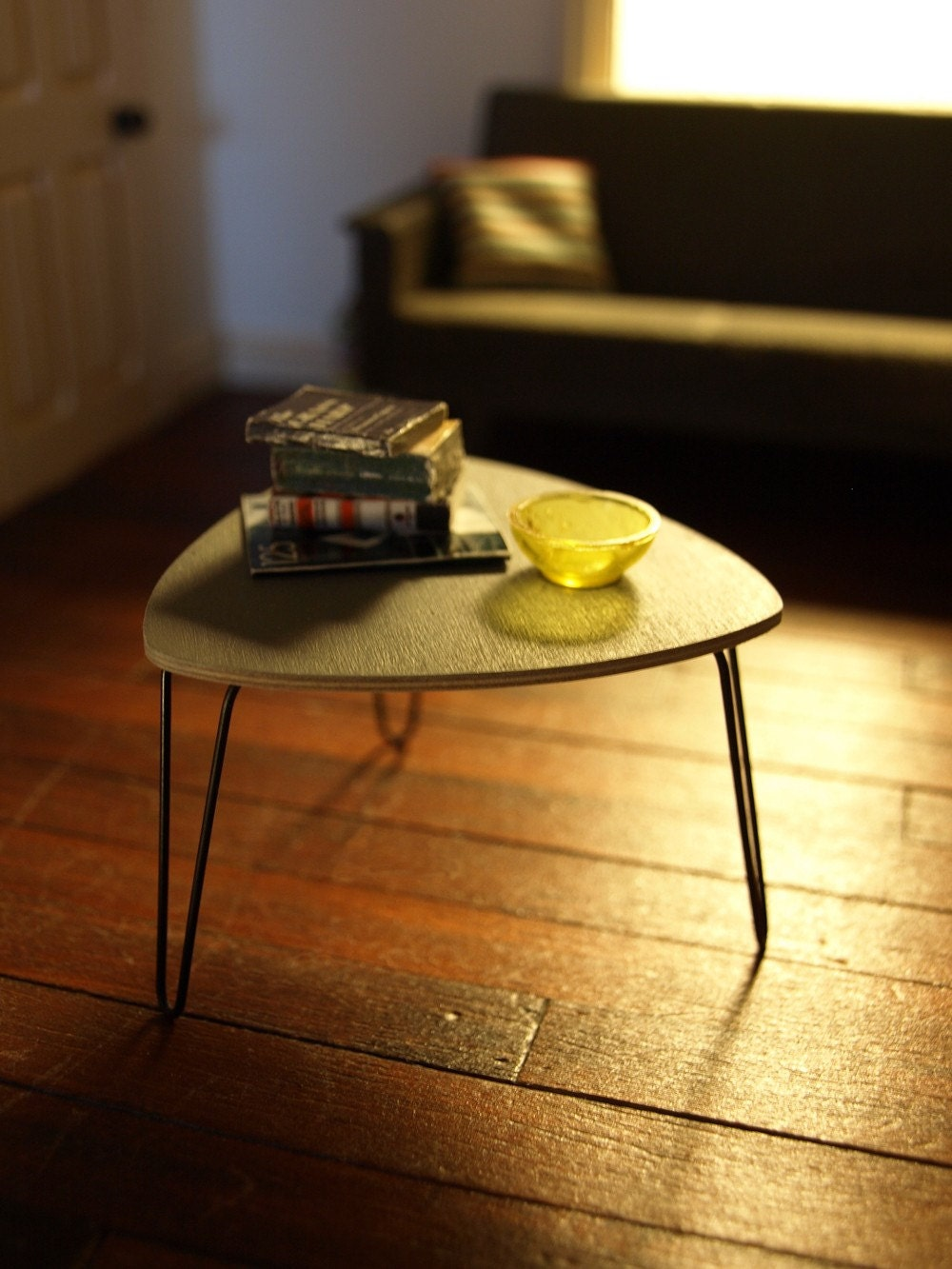 grey triangular coffee table with hairpin legs. Black Bedroom Furniture Sets. Home Design Ideas