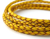LBOLO0325615) 1 meter of 2.5mm Yellow Braided Bolo Leather Cord