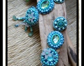 Long mint green and turquoise embroidery earrings