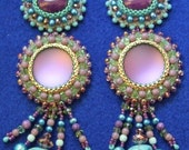 Long turquoise and lilac embroidered earrings with skulls