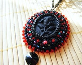 Black and red Iris embroidered pendant