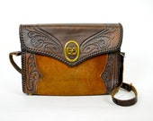 wild western hand tooled leather and suede boho bag