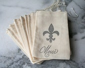 Muslin favor bags, 3x5. Set of 25.   Merci script  with fleur de lis in black on natural white cotton bag.