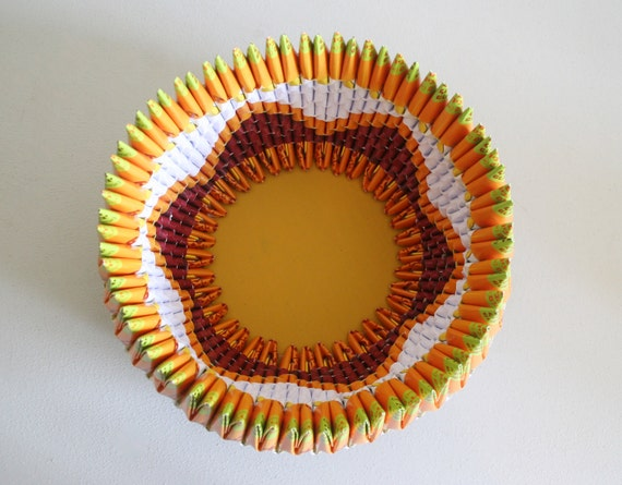 Folded paper bowl with  flower pattern