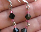 Bicone curious: Pink and black dangly bicone Austrian crystal earrings.