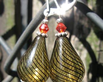 Light and lovely handblown golden brown teardrop glass earrings.