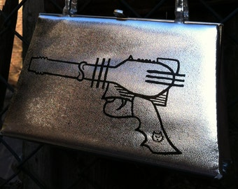 A little bit Barbarella Ray Gun. Silver upcycled hand painted vinyl purse.