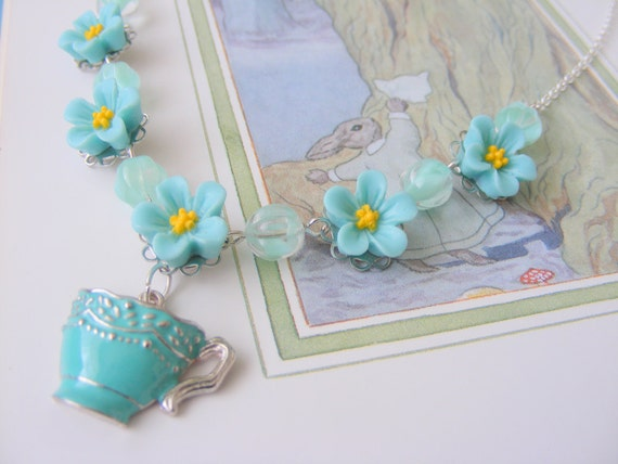 Flower and tea cup in turquoise and aqua, silver plated necklace