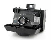 Polaroid The Reporter SE Camera Includes Original Timer and Neck Strap