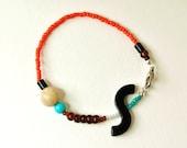 Mixed media bracelet, stacking bracelet, vintage bead bracelet, repurposed bead bracelet, jasper, orange, by nicobel