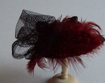 Red silk feather trimmed hat handmade in 1/12th scale dollhouse miniature