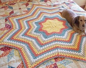 Granny Star, an Eight Point Round Ripple Crochet Pattern.  Make an afghan, baby blanket, or dishcloth as you wish.