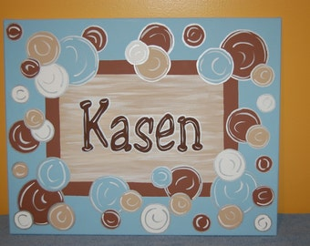 hand painted name sign with polka dots and bubbles