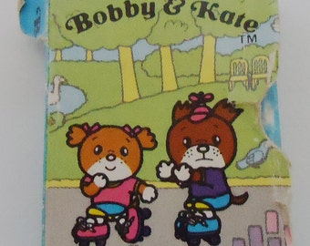Bobby and Kate Book Eraser.80s
