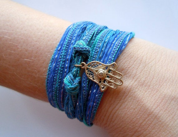 Wrist Wrap Bracelet In Sparkly Blue Green With Gold Hamsa And. African Tanzanite. Pretty Watches. Drawing Watches. Matte Gold Earrings. Cape Diamond. Tension Set Diamond Rings. Jewelry Bangles. Opal Wedding Rings