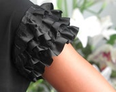 Black dress with ruffled satin cap sleeves