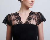 Super sexy little black dress with lacy flutter cap sleeves