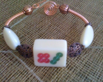 Mahjong and copper bracelet