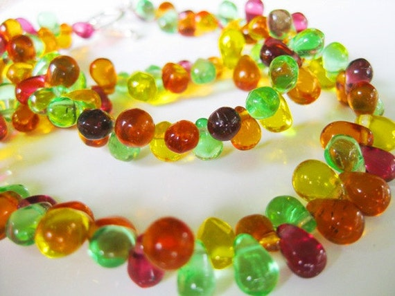 anita.  purple, yellow, orange, and green glass teardrop necklace