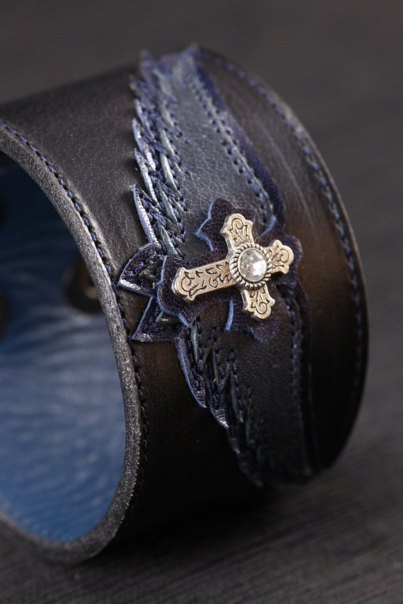 "Leather Cuff: black and blue cuff with a blue angel wing and cross design ""Blue Angel Cuff"""