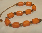 Vintage peach bakelite bead necklace w rose beads