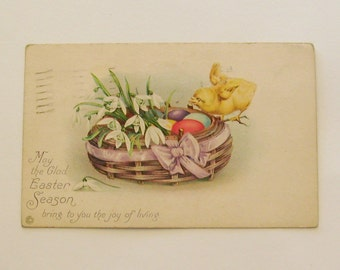 Antique Stetcher Easter postcard chick with basket of lillies and eggs