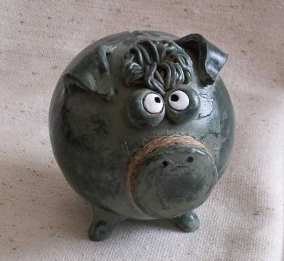 Clay Piggy Bank with a Green Patina