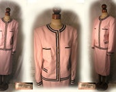 Vintage 1980s couture suit pink silk blend with black trim, chain detail