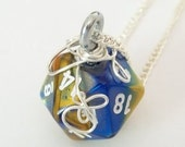 Sterling Silver Wrapped Blue and Yellow  Marbled D20 Dungeons and Dragons Dice Pendant