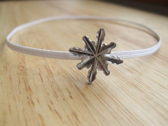 sparkly silver snowflake on skinny white stretchy headband
