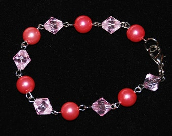 Pink beads on silver tone 8 inch bracelet