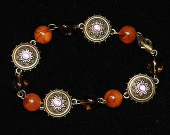 Antique gold tones with beautiful amber beads in an 8 inch bracelet
