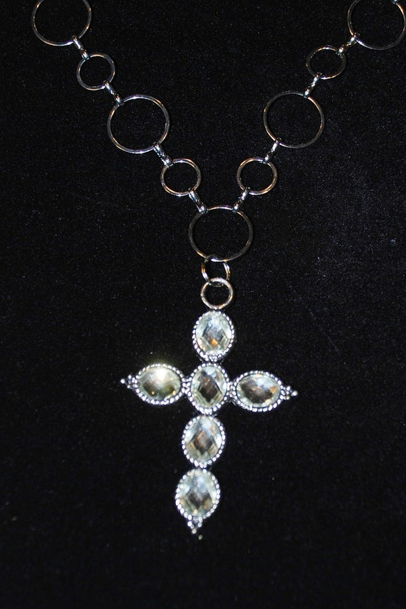 Silver tone circle chain 25 inch necklace with clear stones on a silver tone cross