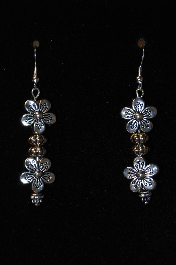 Silver tone with etched black accents metal flower dangle earrings